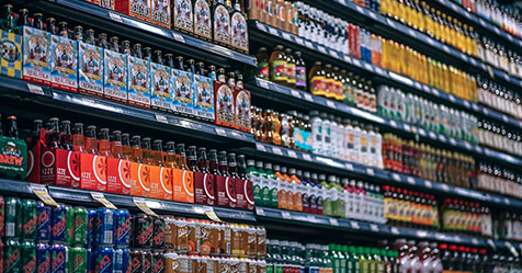 shop shelves stocking bottled drinks
