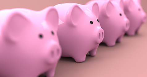 four pink piggy banks in a row